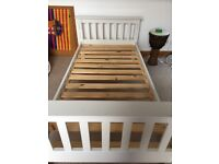 Single bed, white with slatted base, top half of bunk