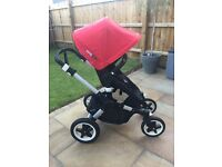 Bugaboo Buffalo travel system with red tailored fabric set and Maxi Cosi car seat adapters