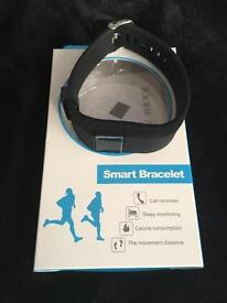 SMART bracelet- BNIB. Compatible with iPhone, Android and Windows