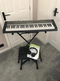 Casio LK-125 keyboard, stand, headphones and stool