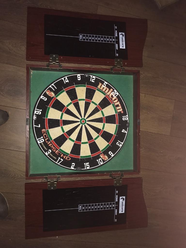 Never used dart board and matt