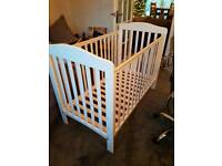 White cot and changing unit