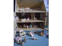 Wooden dolls house with dolls, furniture and accessories