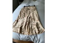 Very pretty Phase Eight flared silk skirt, size 12. 100% silk shell and 100% acetate lining.