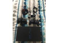 Playstation 2 with 25 games and flat screen tv