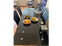 Beautiful extendable black glass dining table