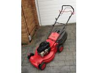 Big Red Petrol lawnmower.