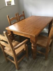 Dining Table/chairs. Quality/Heavy Pine. 6 chairs includes 2 with arms. £275