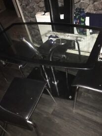 Black table n chairs, chairs bit damage but do sum1 starting of