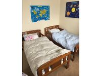 2 wooden toddler beds in very good condition