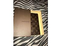 Louis Vuitton purse.