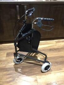 Brandnew 3 wheel walking aid with bag .