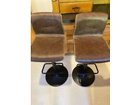 Brown leather effect bar stools