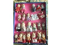 Sylvanian familes figures and carry case/ house