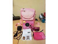 Pink nikon s7000 camera