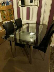 Modern black glass table and chairs