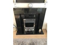 Modern black Marble fire place , back panel and hearth & silver electric fire , excellent condition.