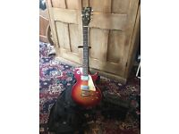 Small electric guitar with stand, case and amp
