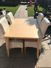 Dining table and 4 faux leather chairs extendable
