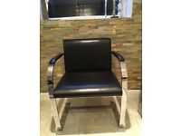 Pair of mid century black leather and chrome chairs Mies van der Rohe style