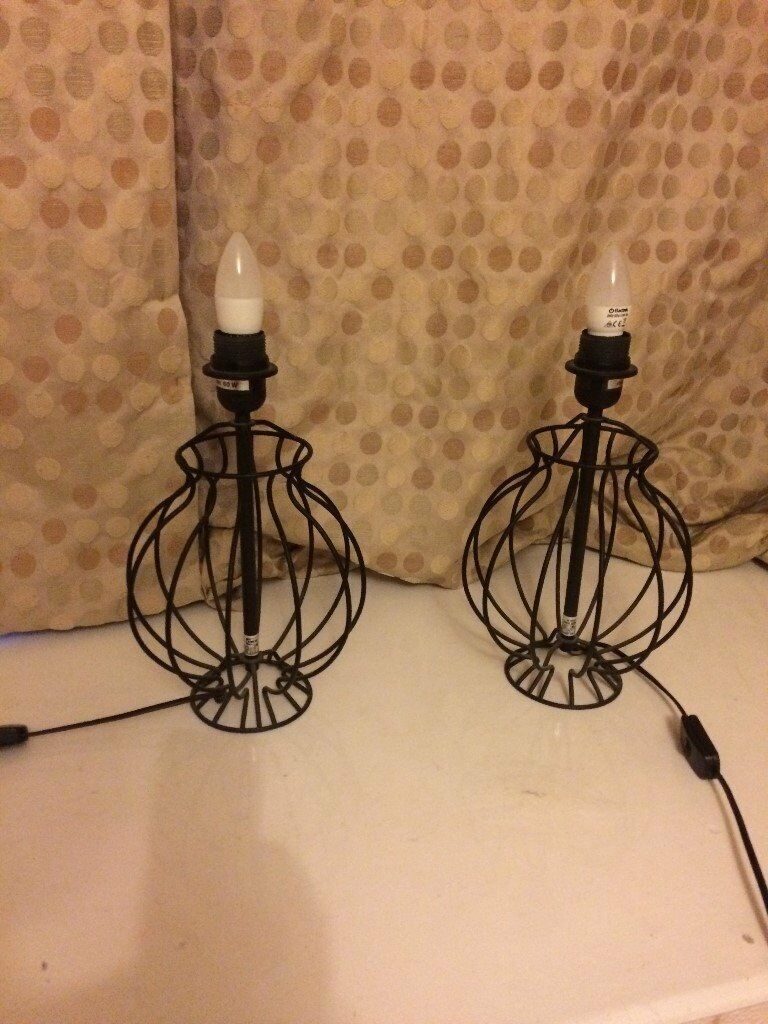 pair of matching black solid metal Ikea bedside table / table lamps (no shades)
