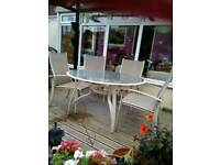 Very sturdy garden table and four stacking chairs
