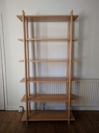 Solid wood well built shelving unit.
