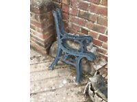 A set of wrought iron bench ends