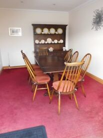 Ercol darkwood dining table and 8 chairs