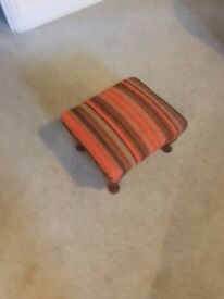 old small upholstered footstool
