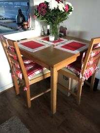 Next Table and Chairs set. 4 chairs, table extends to fit 6
