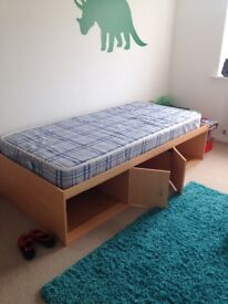 Very good condition single cabin bed with centre cupboard and side storage areas with shelf