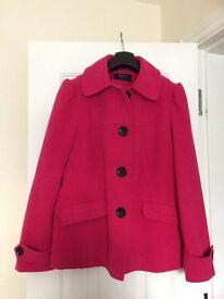 Hot pink coat.