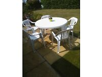 white plastic garden set table & 5 chairs