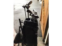 Golf bag and trolley 7 irons 3 woods and putter