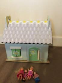 Wooden dolls house with wooden and china furniture