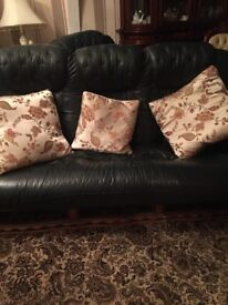 Dark green leather 3 seater sofa and single chair with oak surround in excellent condition £350