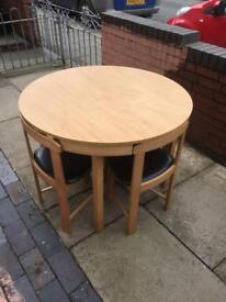 Lovely dining table with 4 chairs great space saver