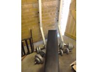Weight bench and two sets of weights