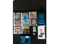Nintendo DSi XL console with 8 games, Super Mario cartridge holder and console and game case.