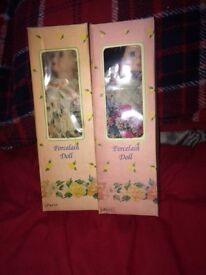 Two small vintage porcelain dolls in box.