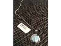 Cute silver necklace with blue footprint disc