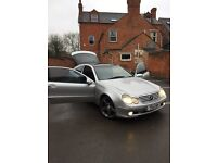 Stunning c class coupe Mercedes Benz, with AMG wheels, panoramic roof, silver colour