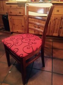 Solid Oak wooden mahogany chair, upholstered in red and black fabric. 2 available.