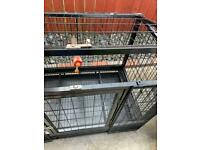Dog cage on wheels. / Parrot cage