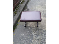 metal framed stool with leather padded seat