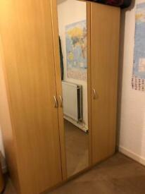 Triple wardrobe with mirror on middle door.