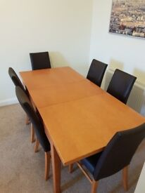 Polished pine table with 6 leather and pine chairs