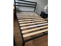 Bedroom set with high black metal double bed