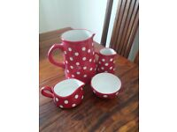 Spotted red and white ceramic jug, milk and cream jug and sugar bowl